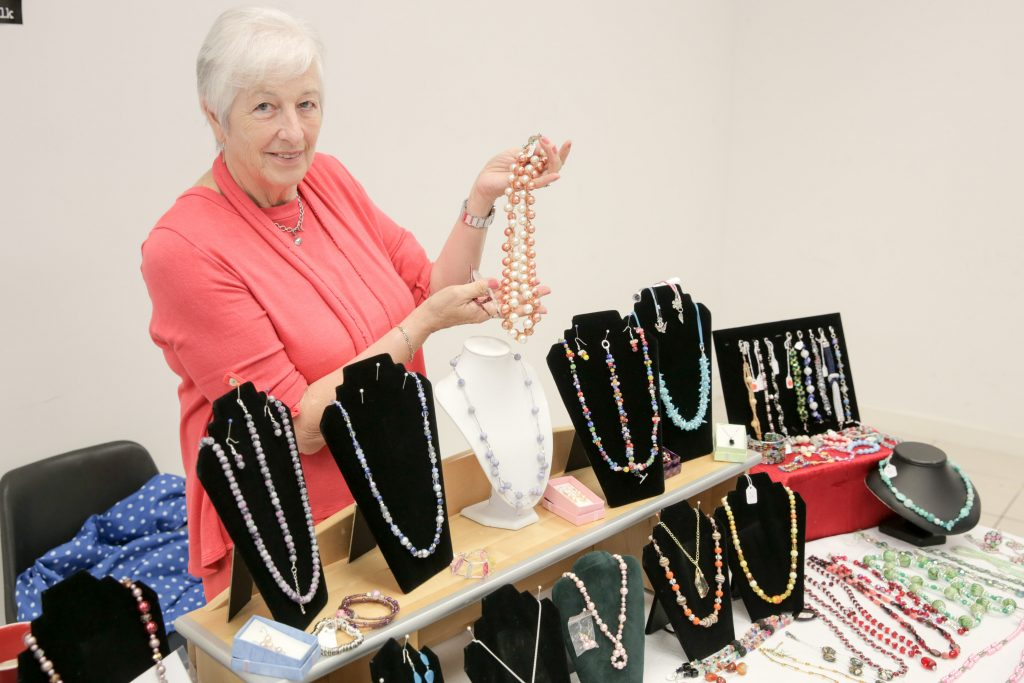 Philip Magowan Photography - Northern Ireland - 05th August 2016 High Street Mall in Portadown hosts a monthly craft fair, on the first Saturday in every month, organised by Sinead McMahon of Danann Crafts. Pictured: Ruby Hamilton displays her crafted necklaces. 50% of all Ruby sells goes to Cancer Research.  Picture: Philip Magowan